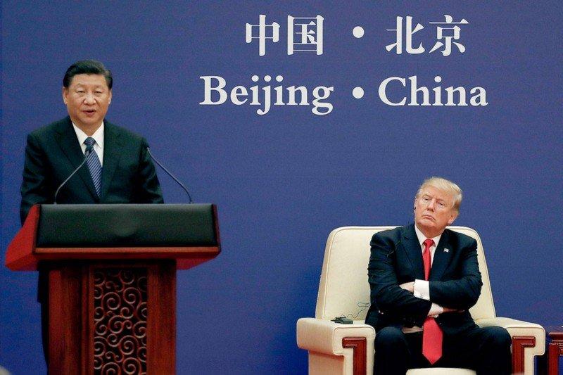 「川習會」熱鬧登場後,美國總統川普卻依舊老神在在,按自己的步調「制裁中國」。攝:Andy Wong/Associated Press