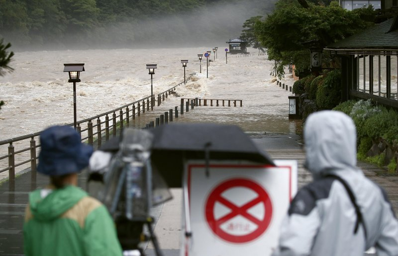 日本豪大雨釀災。攝:Yosuke Mizuno/Kyodo News via Associated Press