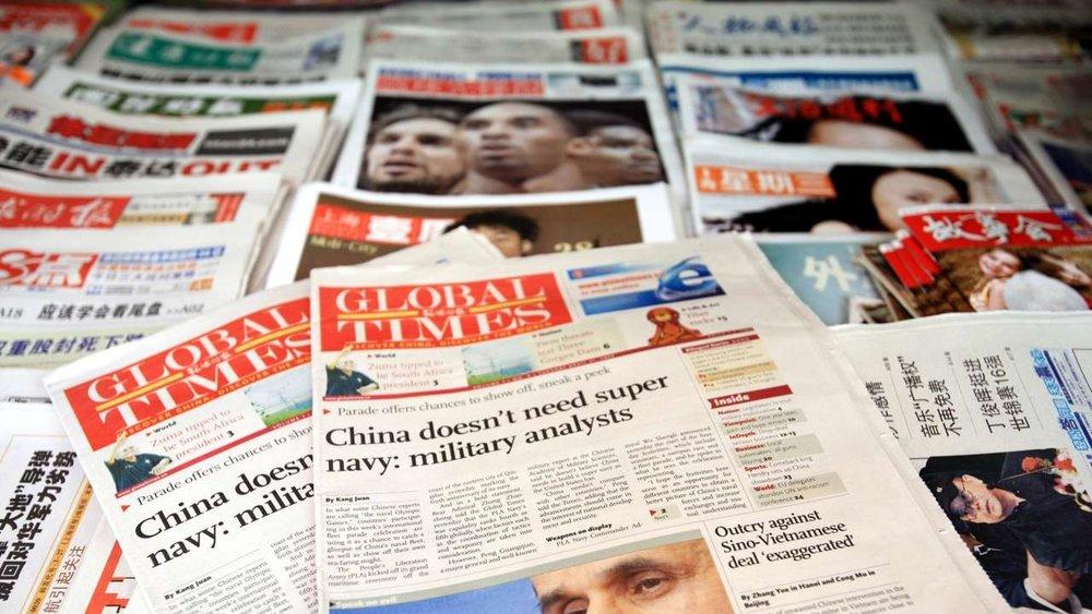 中國媒體在世界各地透過報紙,散播中共的宣傳思想。圖片來源:Imaginechina