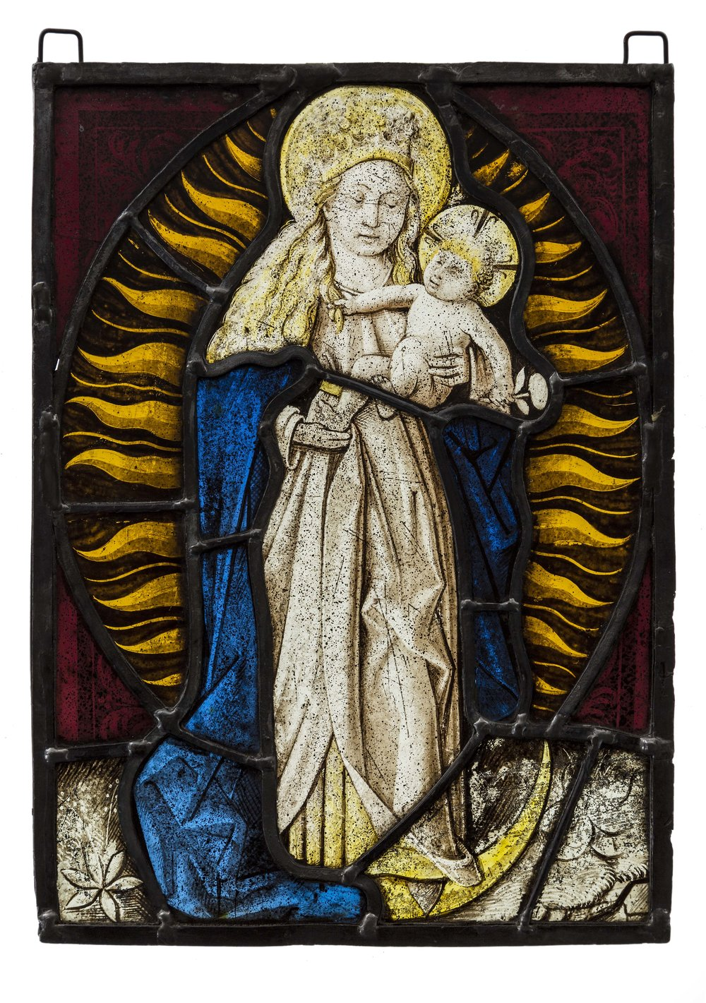 "Artist unknown, Flemish Stained glass, c. late 15th century, The Virgin is depicted as the ""Woman of the Apocalypse"", and is set against stylised sun rays with the moon at her feet; ""the sun for her mantle, the moon under her feet"" (Apocalypse of St John 12:1-2), 27 x 20 cm Australian Catholic University Art Collection Acquired 2017. Image courtesy of ACU University."