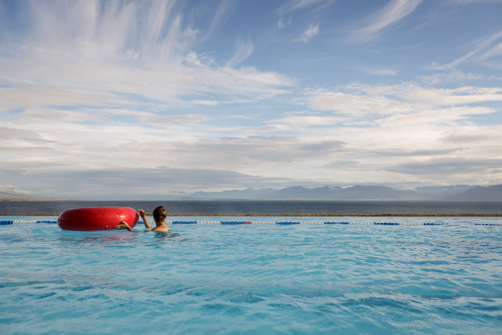 A boy swims in a pool built overlooking the sea in Hofsos.