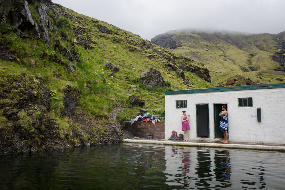 Guests dry off at Seljavallalaug, an outdoor swimming pool built in 1923, nestled in the mountains of southern Iceland.
