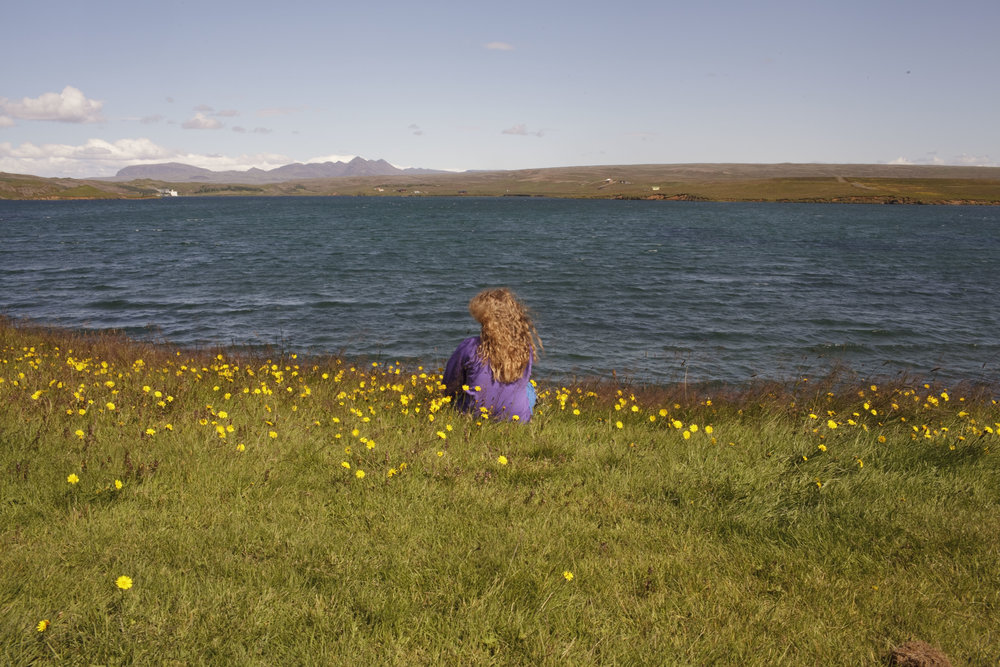 A girl looks out at the lake from the the Úlfljótsvatn camp site, 45 km from Reykjavik, where the 2012 International Scout Jamboree was held in 2012.