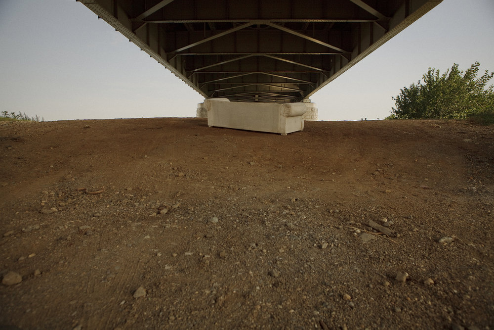 An abandoned couch sits under the Frederick Douglass bridge, east of the river, just across the water from Nationals Stadium. There is a growing gap between development and neglected space in many parts of southeast.