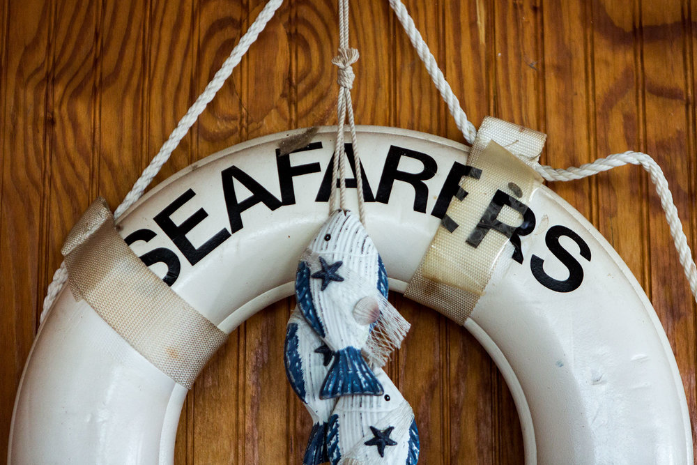 A life preserver bearing Seafarers' name hangs on the wood-paneled wall of the clubhouse.