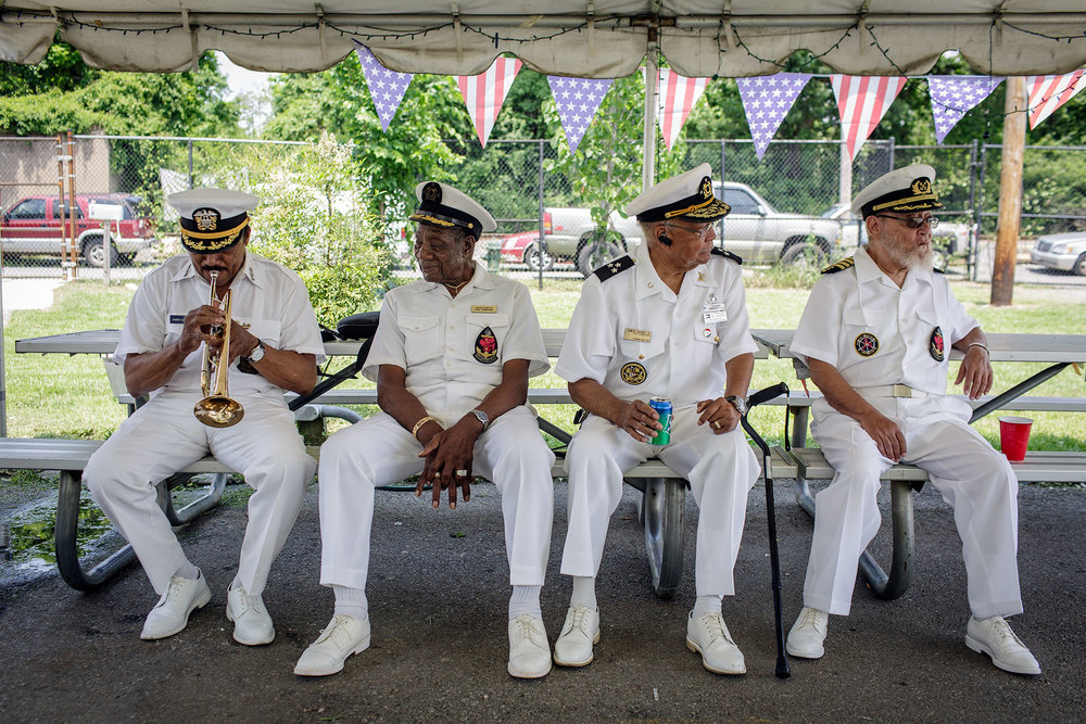 Joseph Quarterman (left), Bob Martin, Howard Gasaway, and Chubby Martin wear their Captain's uniforms as they prepare for the annual flag raising ceremony in June, 2016.