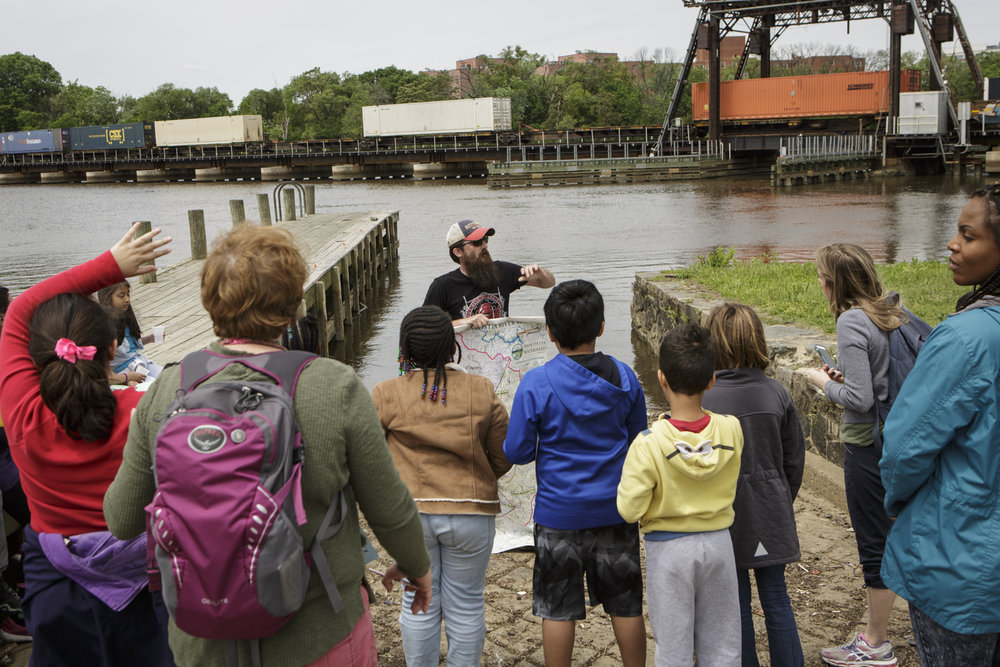Students from Capitol City Public Charter school take part in a shad release day at the Anacostia River in Washington, D.C.