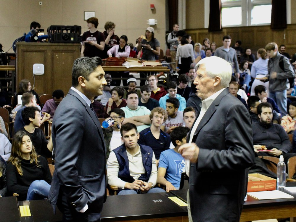 Alderman Ameya Pawar and University of Chicago lecturer Allen Sanderson prepare to debate on the Hyde Park campus Tuesday night. (One Illinois/Ted Cox)