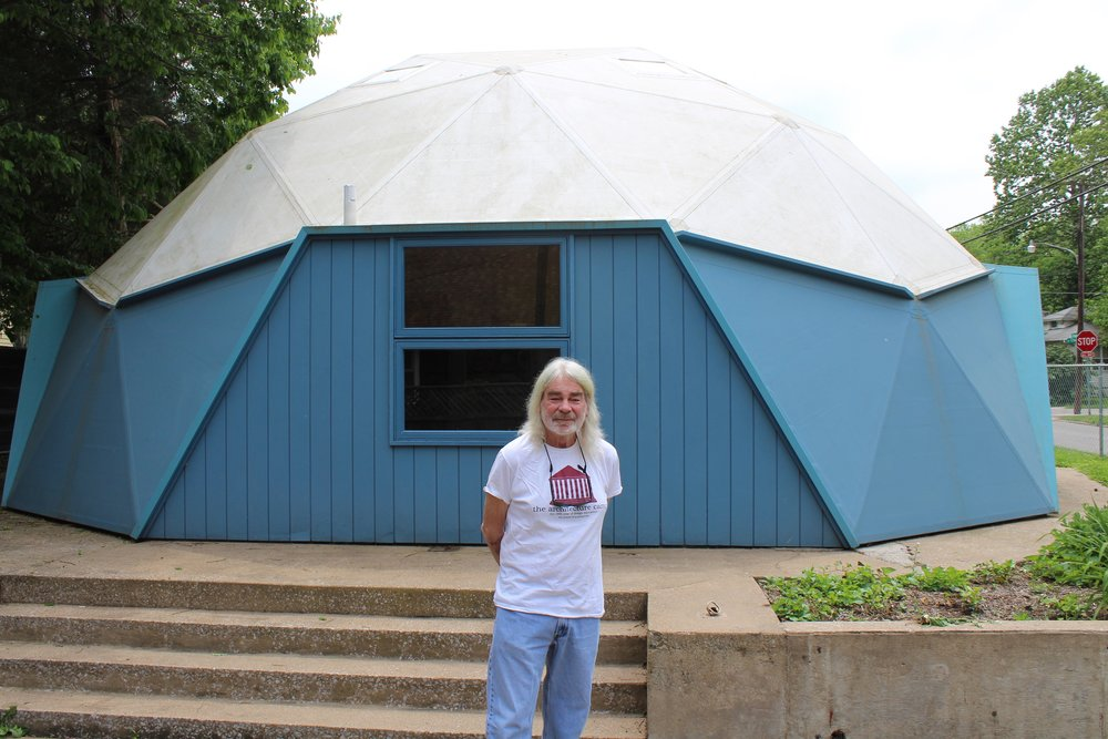 Jon Davey, SIU architecture professor, stands outside the geodesic dome that Buckminster Fuller lived in as his home in the '60s. (One Illinois/Ted Cox)