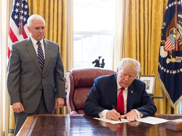 Vice President Mike Pence and President Donald Trump at a previous signing ceremony in the White House Oval Office. (Official White House Photo)