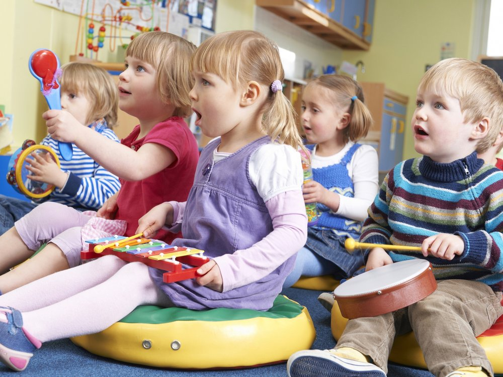 Students learn to play musical instruments in a preschool class. (Shutterstock)