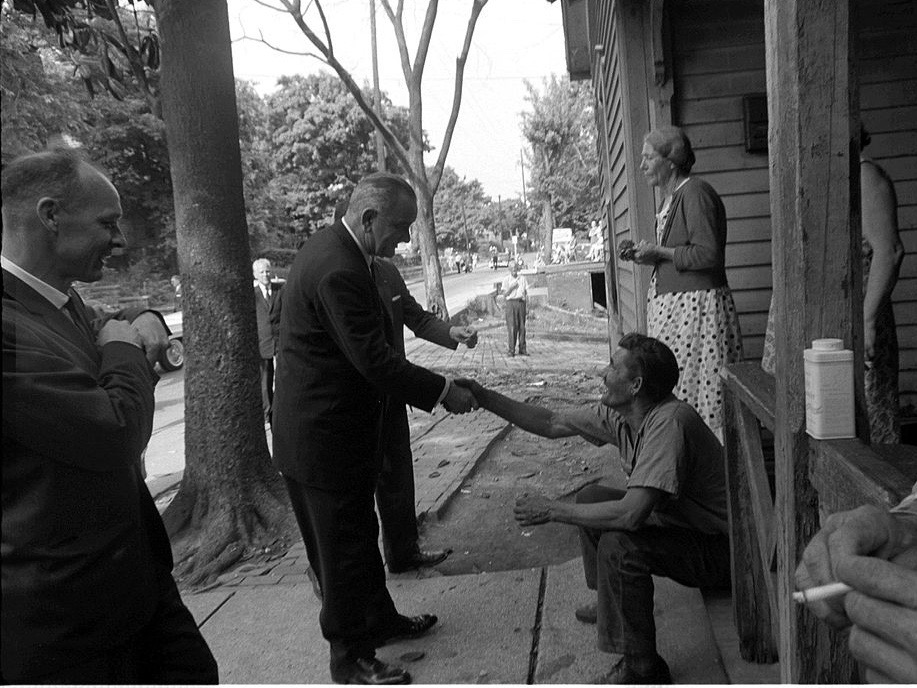 President Lyndon Johnson shakes hands with a farmer on a rural poverty tour in the '60s. (Wikimedia Commons/Cecil Stoughton)