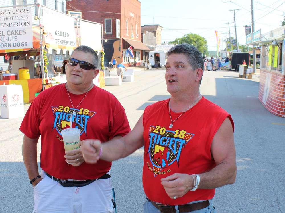 """Marty and Matt Russell talk about how they rev up the crowd as """"tug emcees"""" on the Port Byron side of the Great River Tug Fest. (One Illinois/Ted Cox)"""