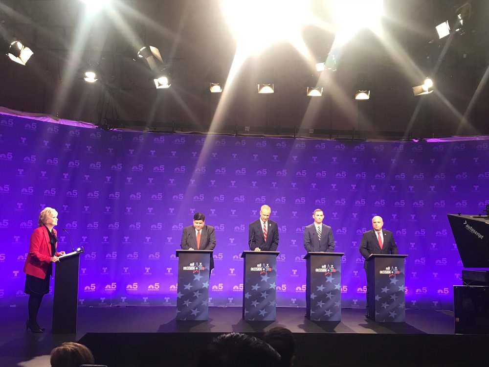 "NBC's Carol Marin, J.B. Pritzker, Gov. Bruce Rauner, Grayson ""Kash"" Jackson, and state Rep. Sam McCann take the stage for Thursday's televised debate. (Twitter/Christian Mitchell)"
