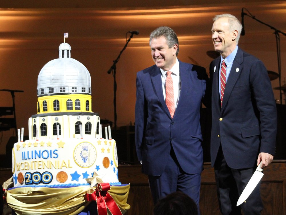 Eli's Cheesecake President Marc Schulman and Gov. Rauner pose after cutting the bicentennial cake. (One Illinois/Ted Cox)