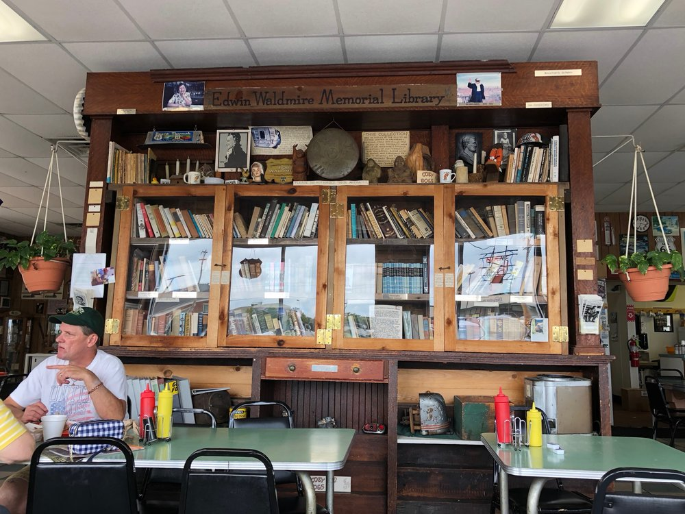 "The Edwin Waldmire Memorial Library stands in the Cozy Dog Drive-In, an homage to his father and to Route 66 from ""hippie artist"" Bob Waldmire. (One Illinois/Ted Cox)"