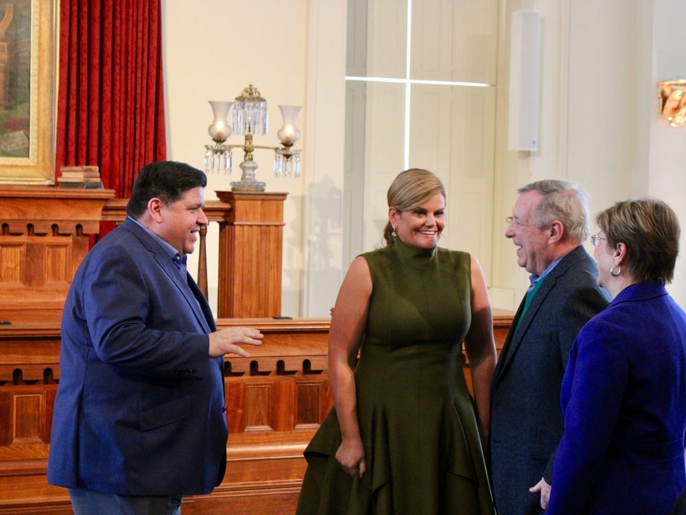 J.B. and M.K. Pritzker greet a couple of Springfield residents, U.S. Sen. Dick Durbin and his wife, Loretta, at an open house held Sunday in the Old State Capitol. (One Illinois/Ted Cox)