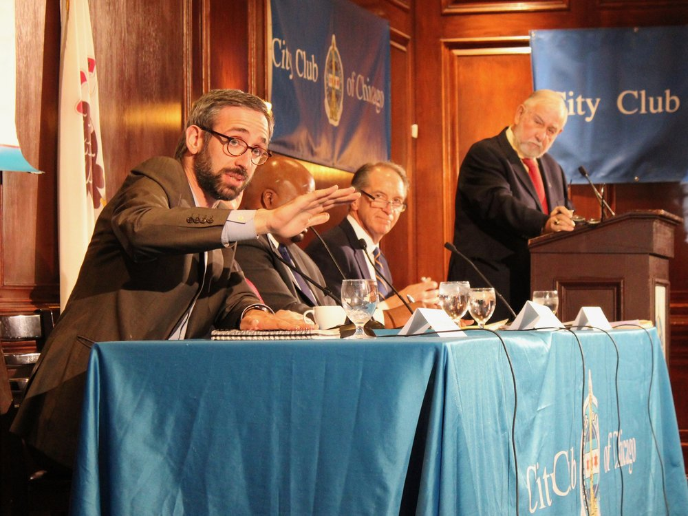 Rep. Will Guzzardi makes a point as Sen. Chuck Weaver (seated to the far right) looks on during Monday's forum on taxes at the City Club of Chicago. (One Illinois/Ted Cox)