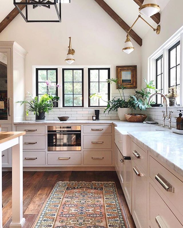 Just can't get enough of this gorgeous kitchen 😍. Love the high ceilings, the black windows, the fabulous lighting.....and that gorgeous vintage rug 👌. By @jeanstofferdesign . . . #kitchendesign #kitchenremodel #kitchendecor #kitcheninspiration #kitchenwindow #kitchensink #kitchenlove #instakitchen #modernfarmhouse #countrykitchen #blackwidow #whitekitchen #kitchenbacksplash #interiordesign #interiordecor #instahome #instadesign