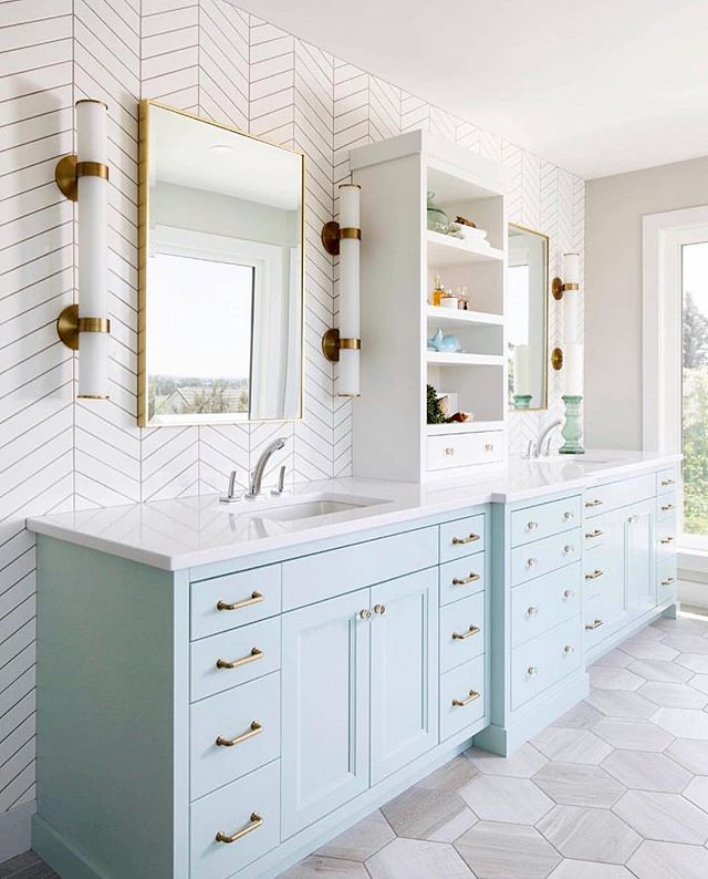 Love a fresh and airy bathroom😍especially one that has lots of storage and this beauty sure does🙌. Beautiful pastel blue vanity, gorgeous Herringbone tiles and fabulous lighting......not to mention all the brass accents!. What more could you want?!. . Via @the_real_houses_of_ig By LD&A, location: Canada ⁣. . . #bathroomdesign #bathroomremodel #bathroomtiles #bathroomvanity #bathroomlighting #bathroomrenovation #bathroomideas #brasshardware #masterbathroom #herringbone #blueandwhite #coastalstyle #lightandairy #instabathroom #coastalbathroom #bathroomstorage