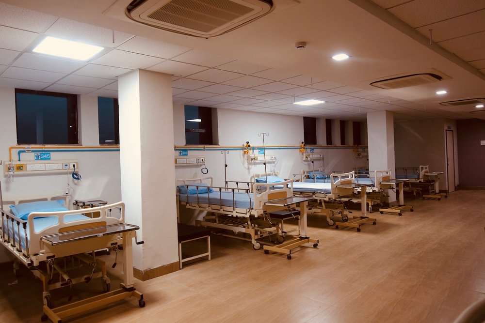 General Ward -   9 bed Centrally Air conditioned wards  2 Toilet for 9 beds.  Patient Bed Side Table.  Attendant Couch.  In Room Cafeteria Service for the patient.  Adjustable bed.  Patient side Nurse call system along with intercom.  2 Patient trolleys.