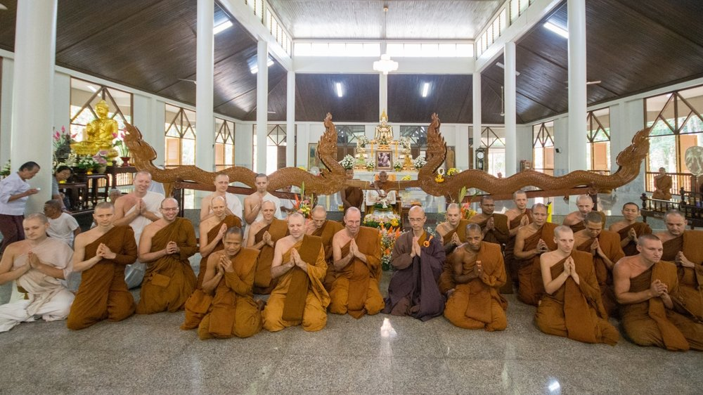 The tradition of pouring water over the hands of senior monks and elder people on Songkran day (Thai new year) is a beautiful gesture of respect maintained in the northeastern culture. On April 12, 2019 the Sangha of Wat Pah Nanachat went over to pay hommage to Luang Por Liem at Wat Nong Pah Pong, who received a stream of water over his hands coming down from two wooden naga-sculptures that cannel the water the disciples offer.