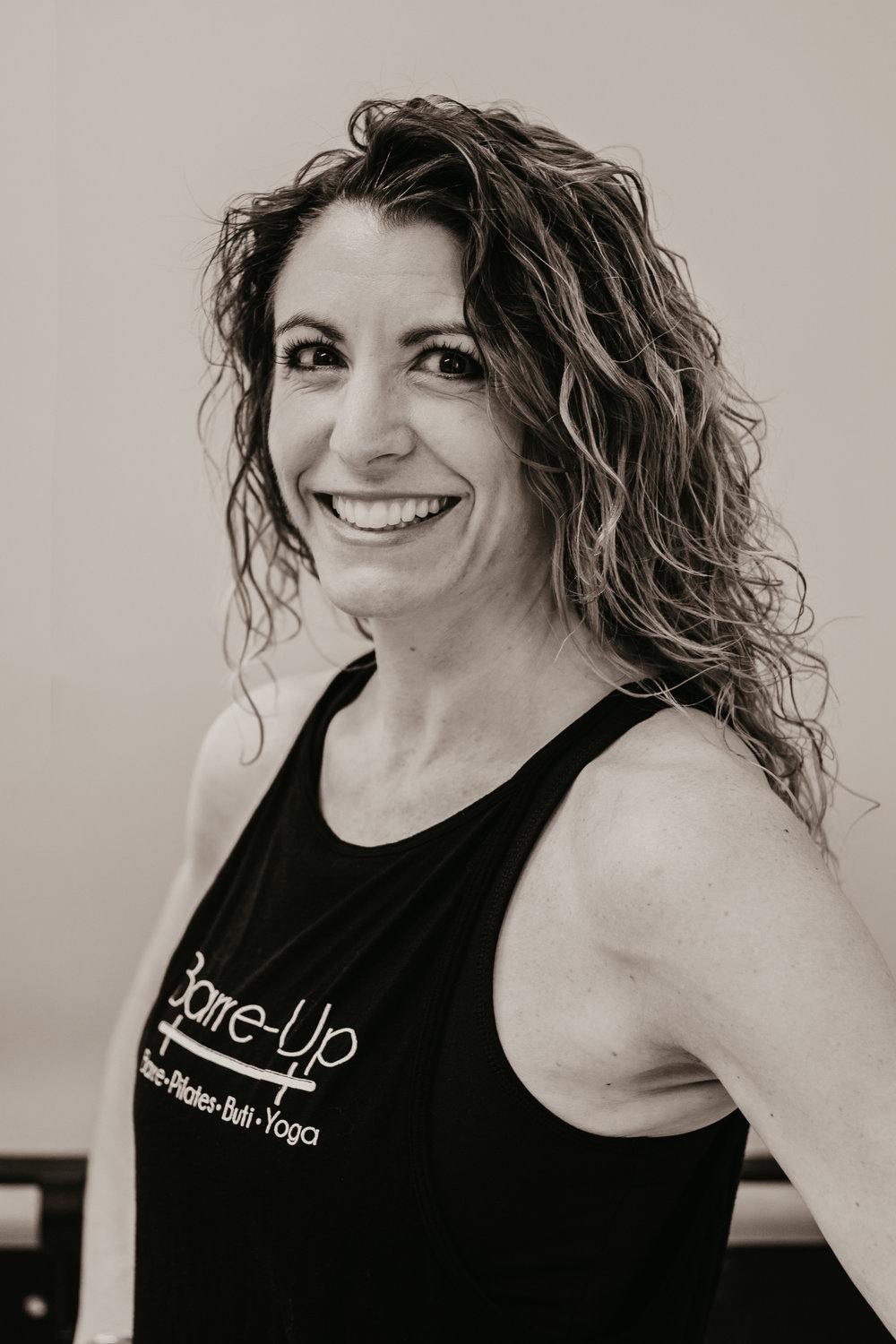 Jen M. - Jen is a FT mom, wife, and learner as well as joy & peace seeker. She is also a PT speech therapist, yoga instructor, runner, knitter and concertgoer. She found the Barre-up studio when looking for something more after 20+ years of running and practicing yoga (mainly Vinyasa styled). She found that Buti Yoga combined the cardio, strength and flexibility aspects nicely in one packaged hour and while she continues to enjoy recreational running and other types of yoga she was also searching for a balance. Having always been a good student, becoming an instructor allowed her to learn more, practice better and prepare to share the joy of Buti, Vinyasa, and Yin yoga with others. She is trained in RYT-200 with certifications in Buti Yoga, Kids Yoga and most recently Yin Yoga where she studied with Bernie Clark in Vancouver, British Columbia, Canada.She hasn't regretted one iota of the journey and thoroughly enjoys teaching classes just as much as she continues to enjoy taking classes.Her favorite food is buttered toast, she's picky about her beer, she believes one could never have enough shoes and her favorite 2nd family is her Barre-up family