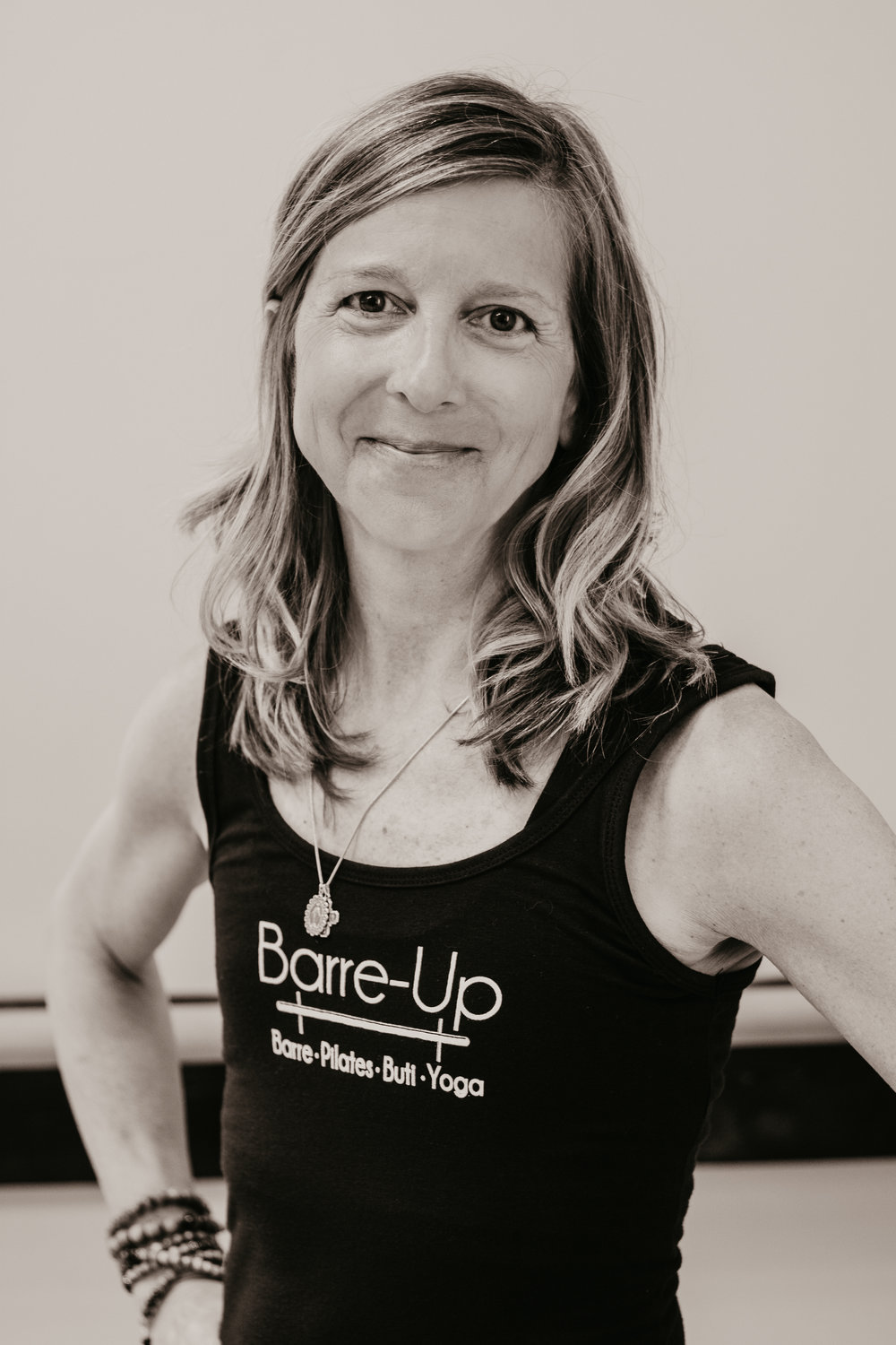 Elisabeth G. - A recent yoga-holic, Elisabeth considers Barre-Up as a second home and inspiration for her to become an instructor. She most enjoys the energy, friendly and accepting environment, and mental indulgence from the workout and classes. She has also greatly broadened her music knowledge as an instructor. Elisabeth is RYT 200 and Buti Yoga certified. She teaches Buti, Vinyasa, and Yin Yoga.Aside from yoga, Elisabeth keeps busy working and traveling for her market research company which she started with a business partner, 14 years ago. When she is not working or practicing yoga, she can be found enjoying time her with family, bicycling with her husband, or taking every opportunity to visit her two daughters.