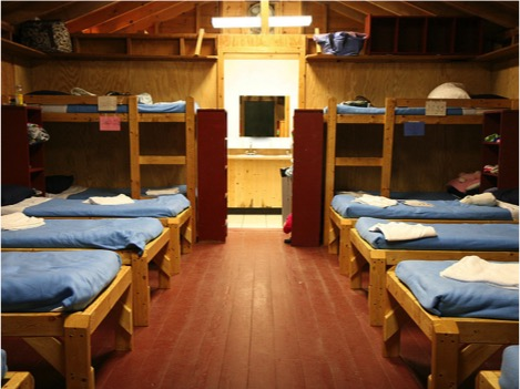 We have new wooden beds with comfortable mattresses. Knotty pine walls with large windows. Your cabin will become your home away from home for the weekend.