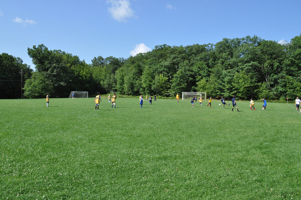 Play outside all day at one of our soccer, lacrosse or football fields, beach volleyball court, indoor hockey rink, two gaga courts, two baseball fields, three outdoor basketball courts,golf driving range and a putting green.