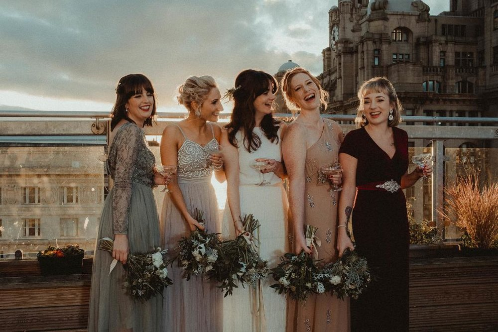 Kate and her bridesmaids on the roof top of OhMeOhMy wedding venue.