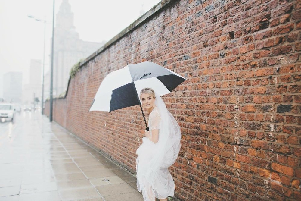 Kelly having fun in the rain with her Jenny packham gown -