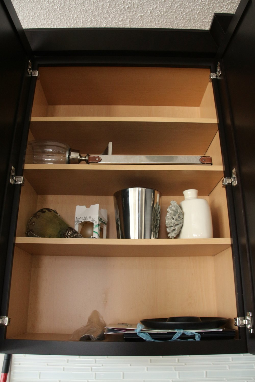 Before-Under utilized kitchen cupboard