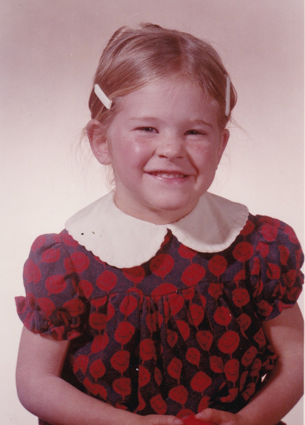 Me in Kindergarten.  I loved my smiley face dress.