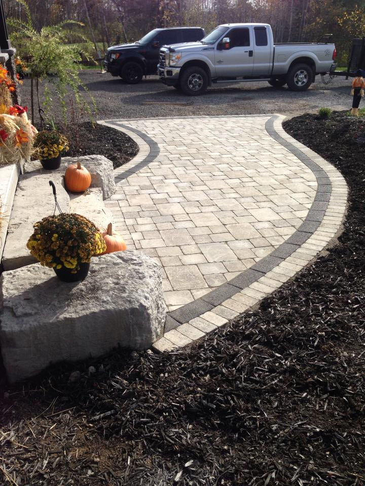 An Elegant Modern Grand Entrance Done With Our Strada Antico Grey And Strada Ultra Black In-Lay Paver
