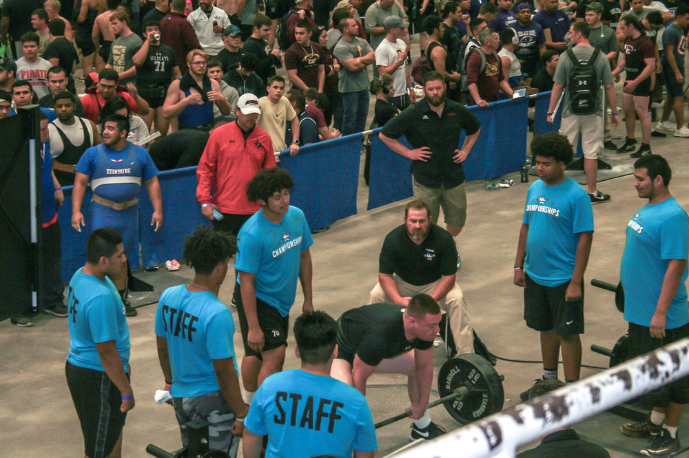 Image From Championships: Before 3,000 spectators and 1,500 athletes, Kade prepares to squat 585 pounds