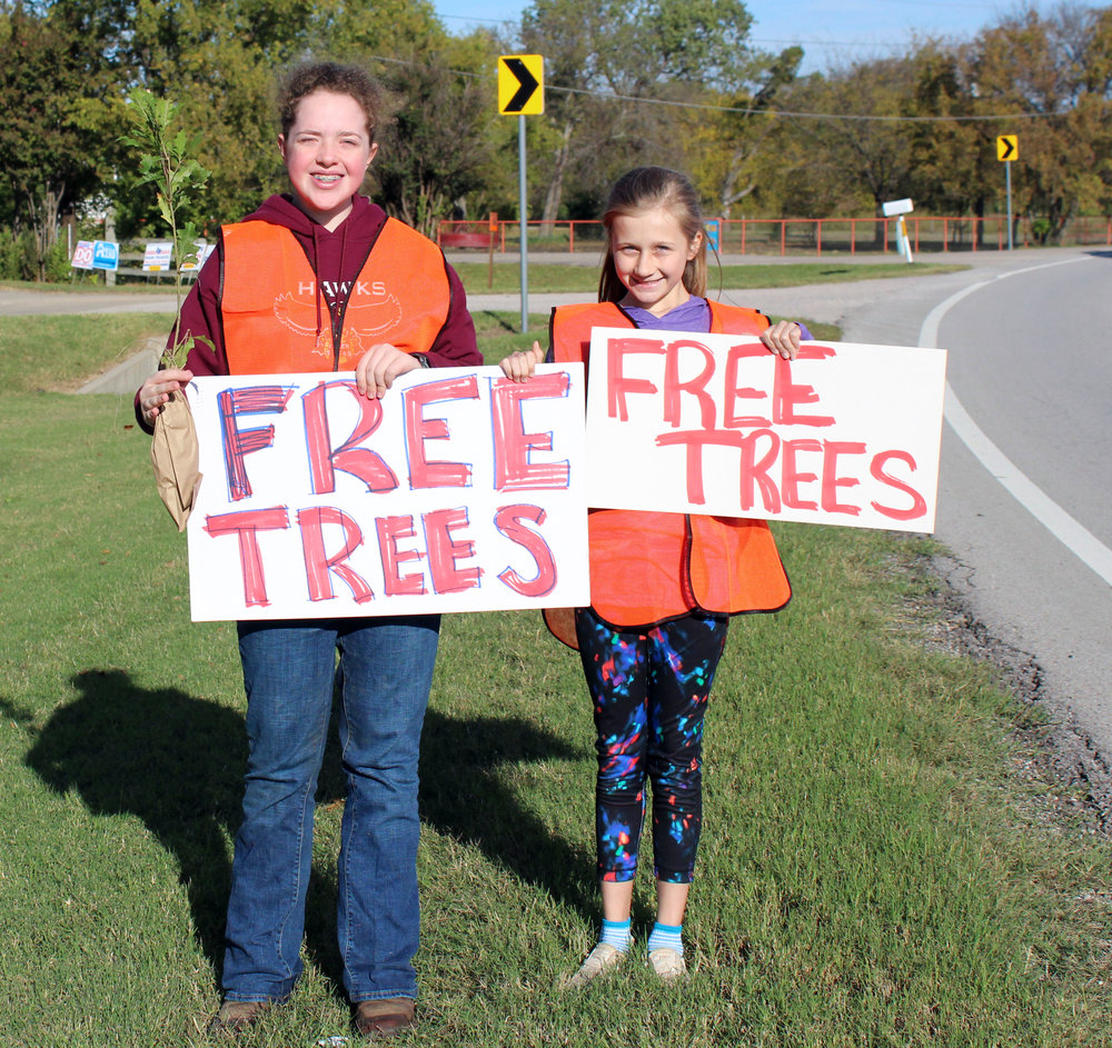 Members of Legacy 4H invited people driving by to pick up a free tree