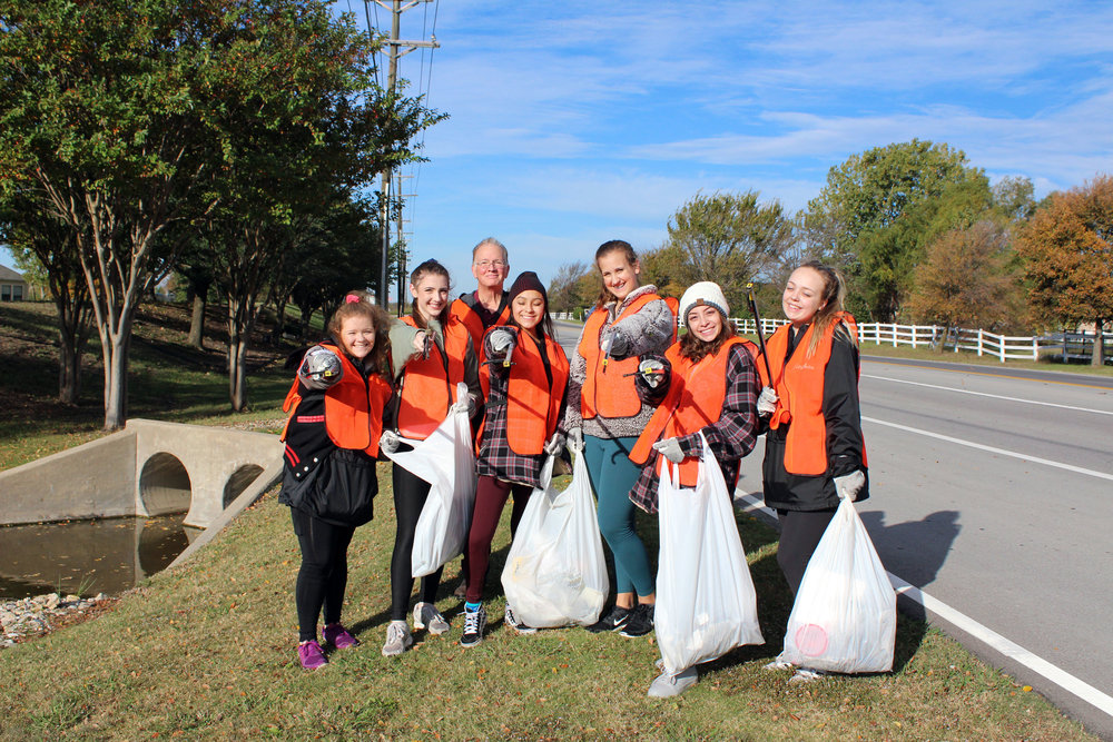 City of Lucas employee Jim Hurley accompanied members of the Lovejoy High School Majestics dance team while they cleaned up Lucas Road. (from left) Lyndsey Toft, Sophie Shay, Melannie Montalvo, Grace Guzinski, Debbie Montalvo and Meghan Maxwell.