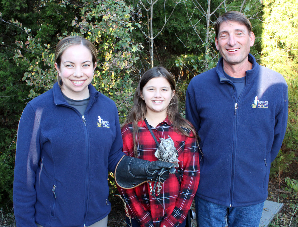 (From left) Elizabeth Carter, BPRC Education Manager, holding Jessie (Eastern Screech Owl), Madison Mejia and Erich Neupert, Executive Director of BPRC.