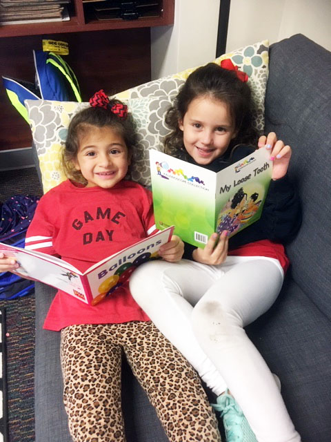 Solenne Vela and Nora Price enjoying books from the Literacy Library