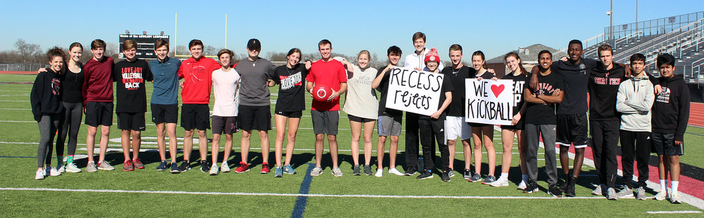 As his senior project, Brian Wolfe (center, holding kickball) organized a kickball tournament benefiting Alzheimer's Association.