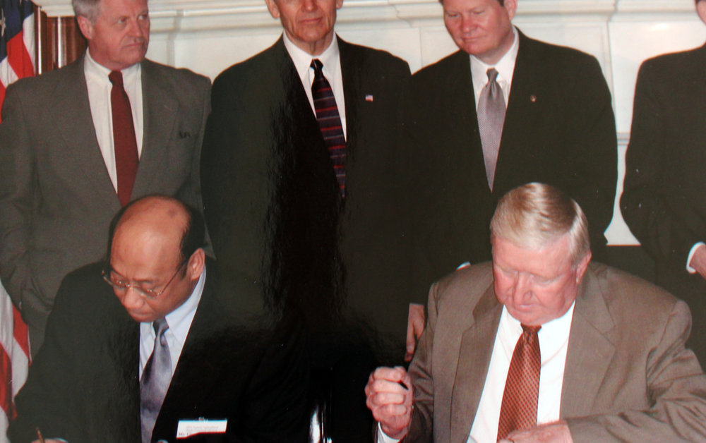 Dale Spurgin in Washington D.C. signing a contract with a dignitary from Taiwan. The contract was an agreement that Taiwan would purchase millions of dollars of grain from the U.S.