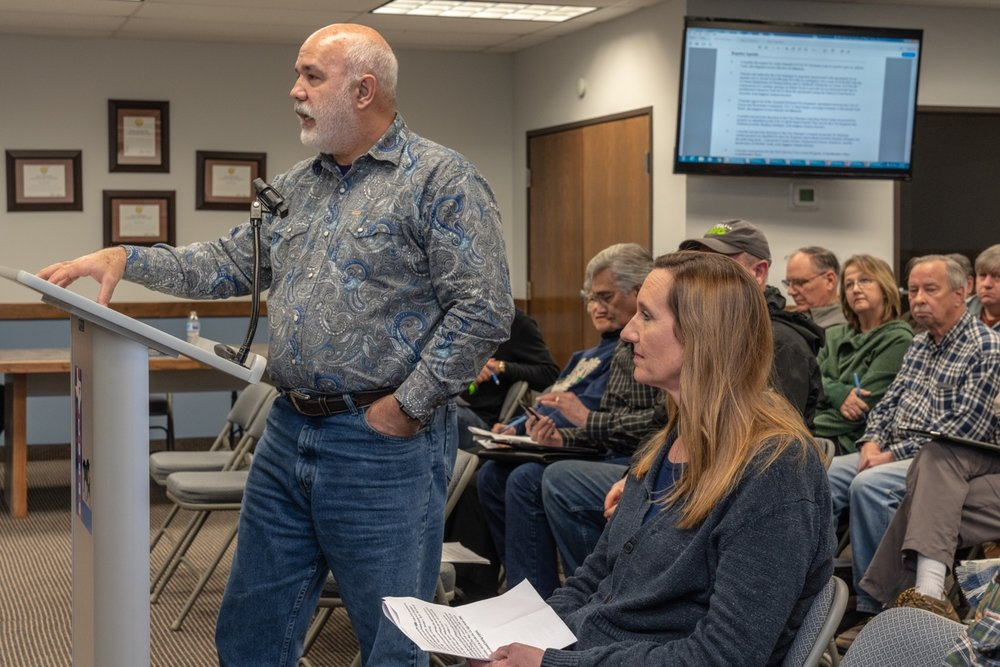 Lucas City Engineer Stanton Foerster (at the podium) and Anita Ahmadi (seated to his left) address the Allison Lane access problems with the city council.