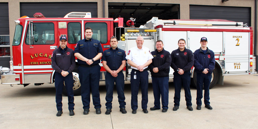 Lucas Fire Rescue A Shift in front of Engine 862. (From left) Firefighter/Paramedic Michael Dunnam, EMS Officer Aaron Alderdice, Captain Ethan Carver, Chief Ted Stephens, Assistant Chief Lance Grant, Firefighter/Paramedic Joe Krizan and Volunteer Emergency Responder Brayden Jackson.