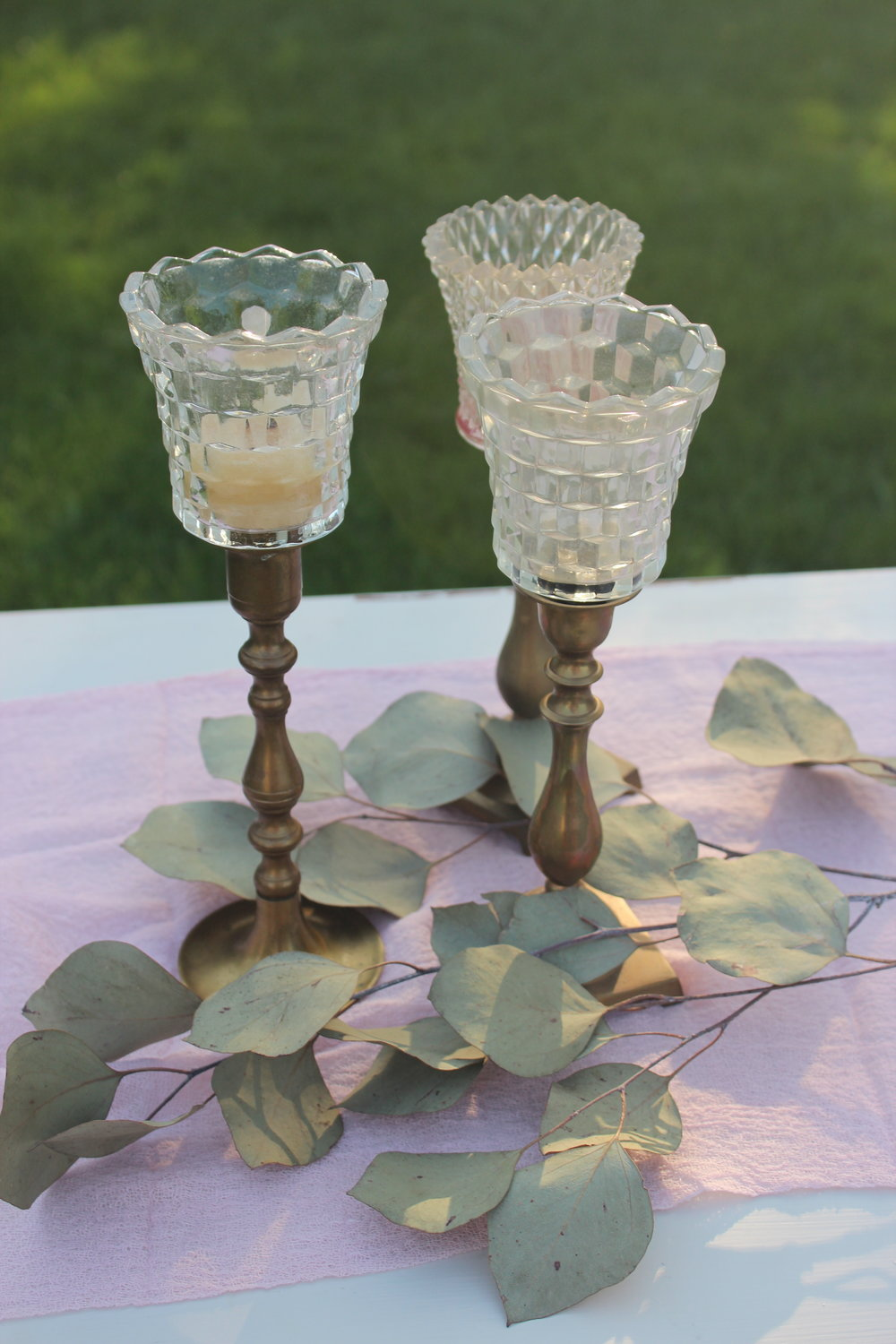 Small Gold Candlesticks enclosed with glass