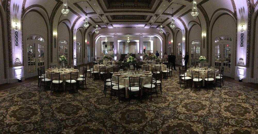 White colored uplighting Quad Cities Wedding Professionals