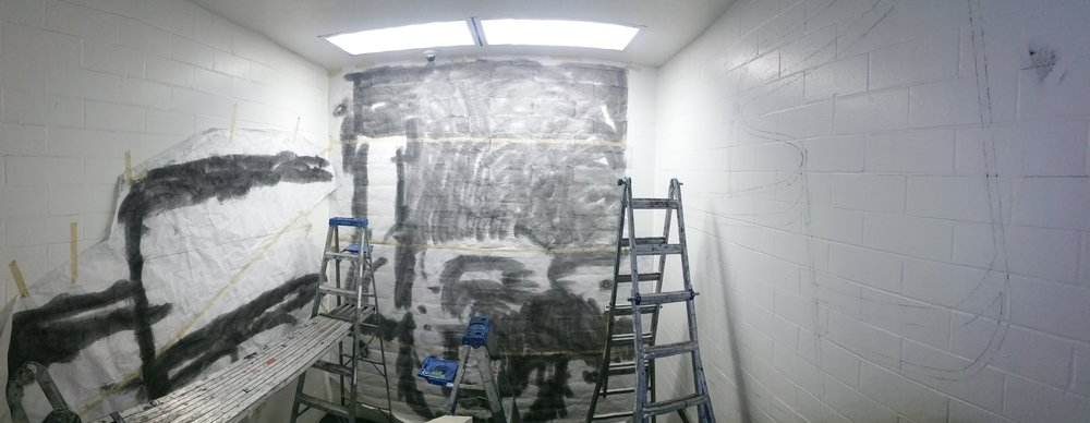 Once on site, ladders set up, the paper patterns are taped up in place on the wall and charcoal is pushed through the perforated holes to transfer the design.