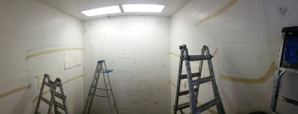 Since parts of the design will be white, to avoid the typical double-coating necessary I mask the white portions before painting. Even if small amounts of paint bleed under the tape (on this textured wall, it happened a bit) they can be painted over easily.