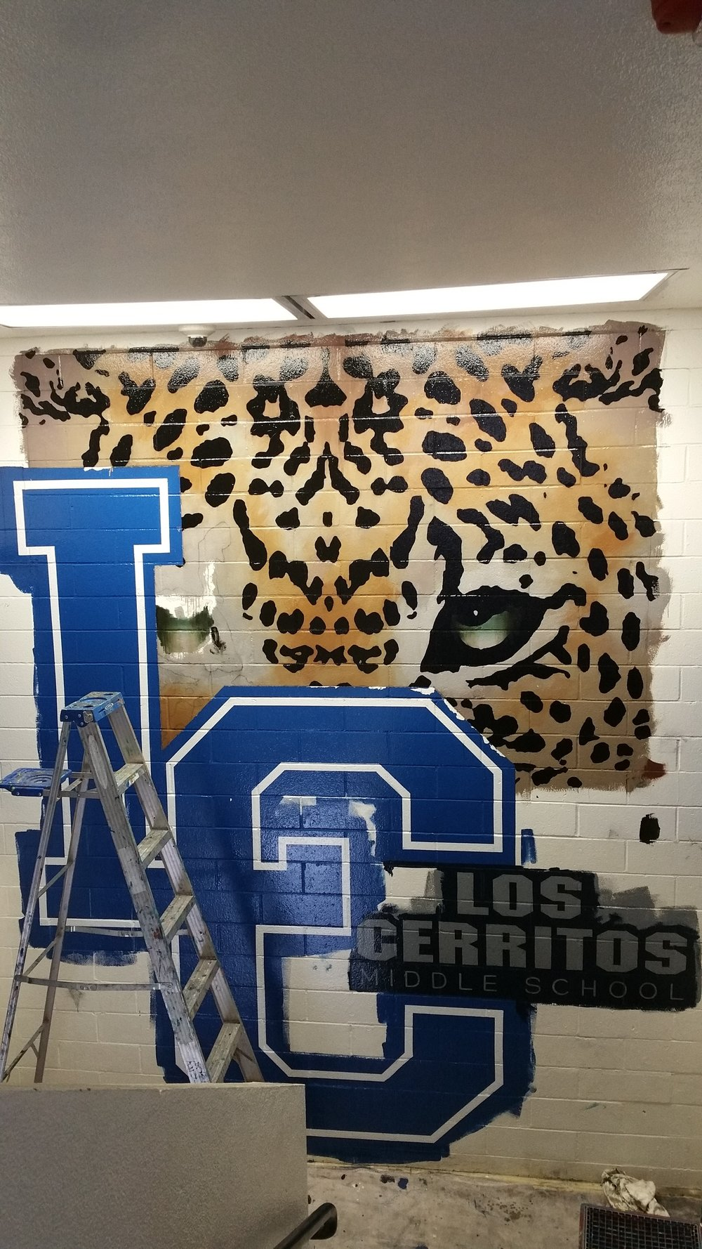 Third day saw the final work being done.More blending on the eyes… cut-in the background color around the lettering… paint the leopard's infamous spots…