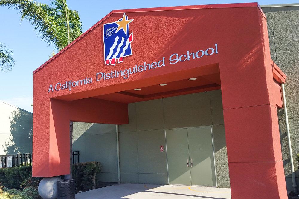 Perdew Elementary Distinguished School Award signs